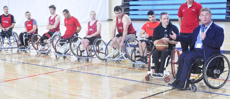 Rick Hansen and wheelchair basketball team.