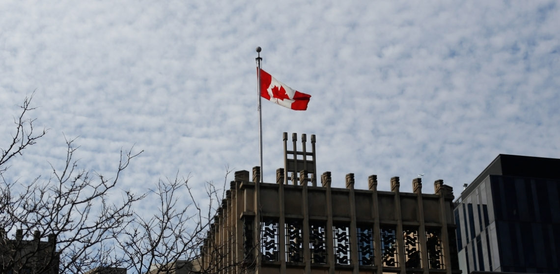 canadian flag atop massey college