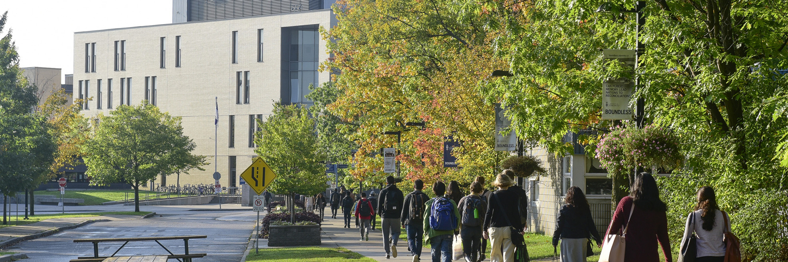 students walking to AA building
