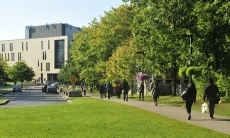 Students walking towards the AA Building
