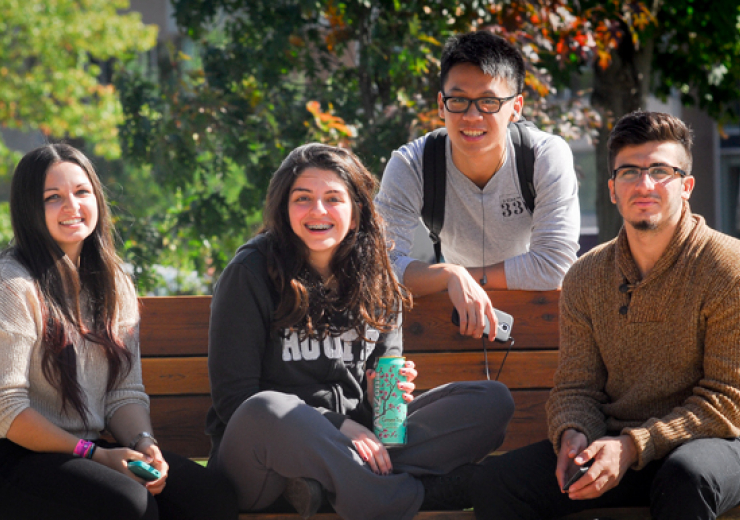 students on a bench outdoors