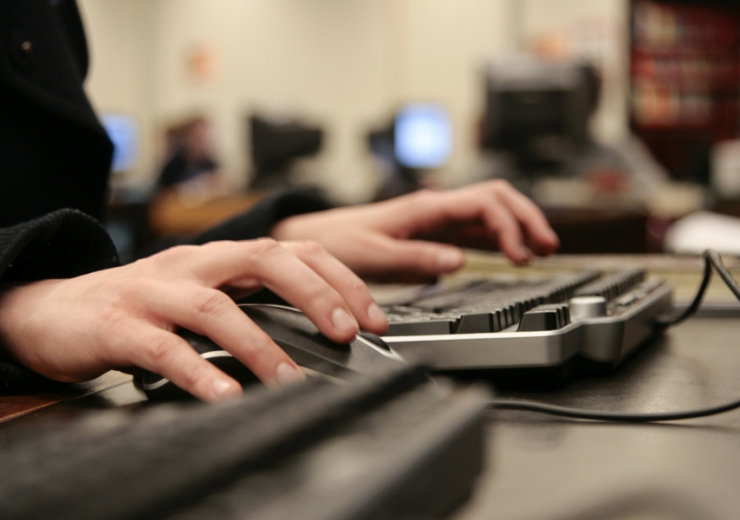 Student on keyboard and mouse