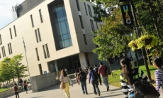 Students walking to the Arts & Administration building