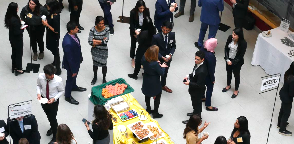 Group of students and employers networking