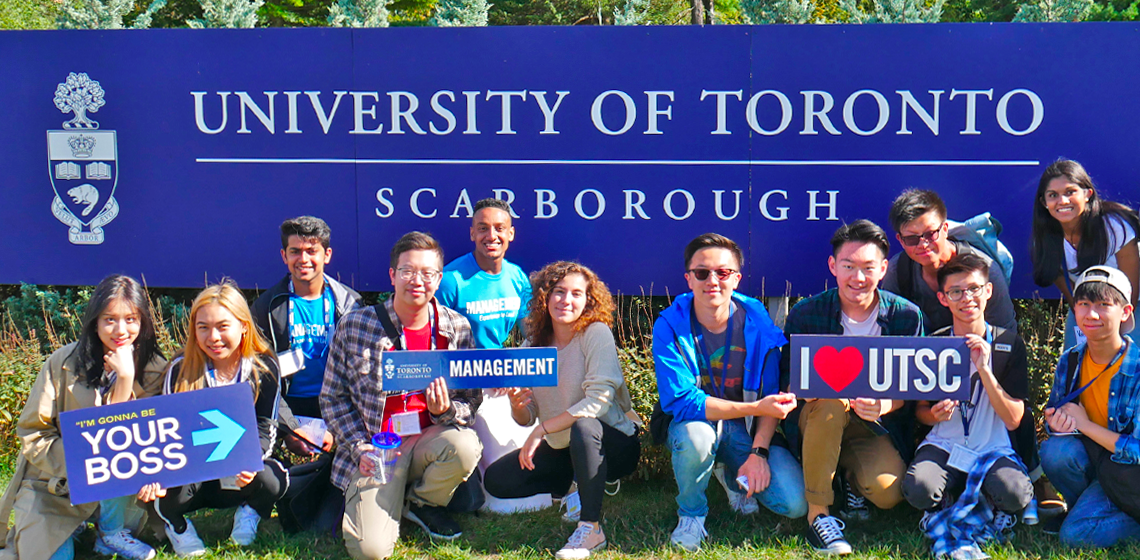 A group of first-year students in front of the U of T Scarborough sign