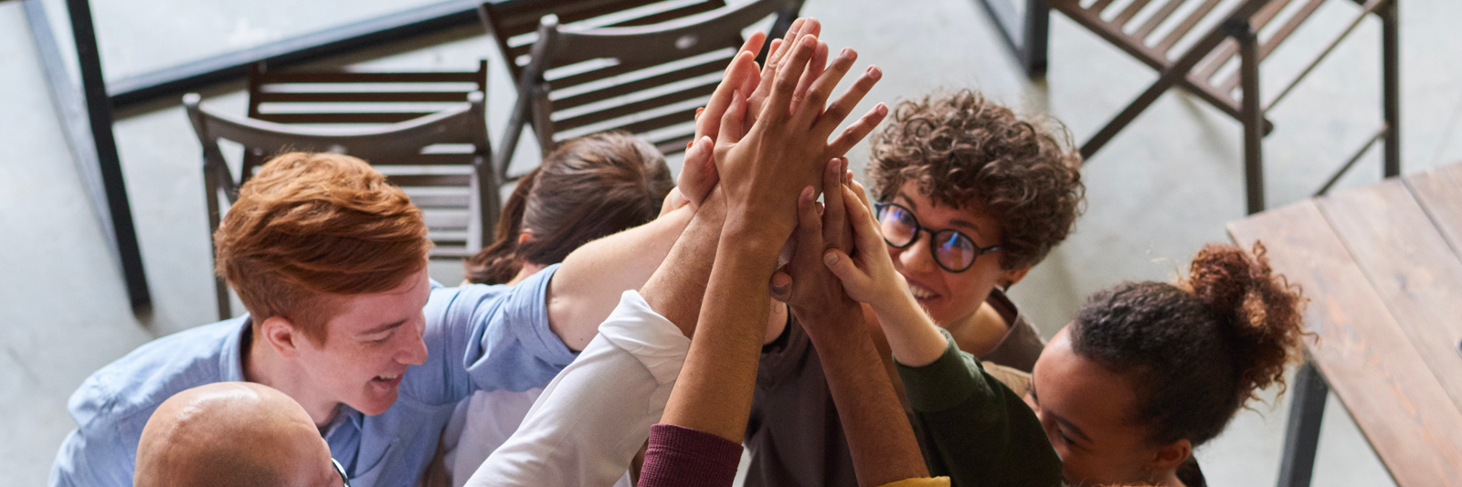 A diverse group of students giving each other high-fives