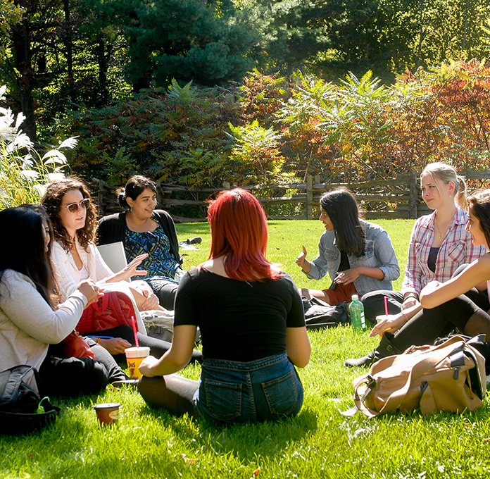 UTSC students sitting in a circle outside