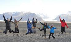 students jumping for joy in iceland