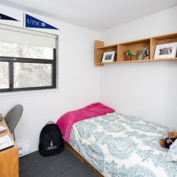 Single bedroom with desk and storage