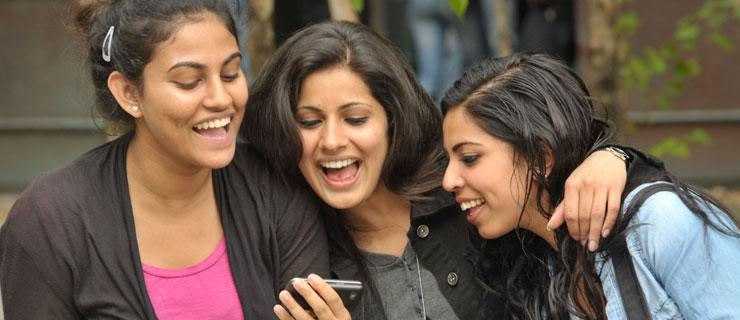 Students looking at a phone picture together