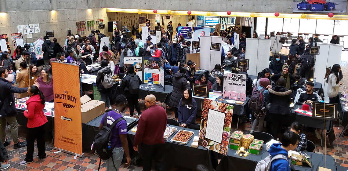 Crowd of students tabling at event