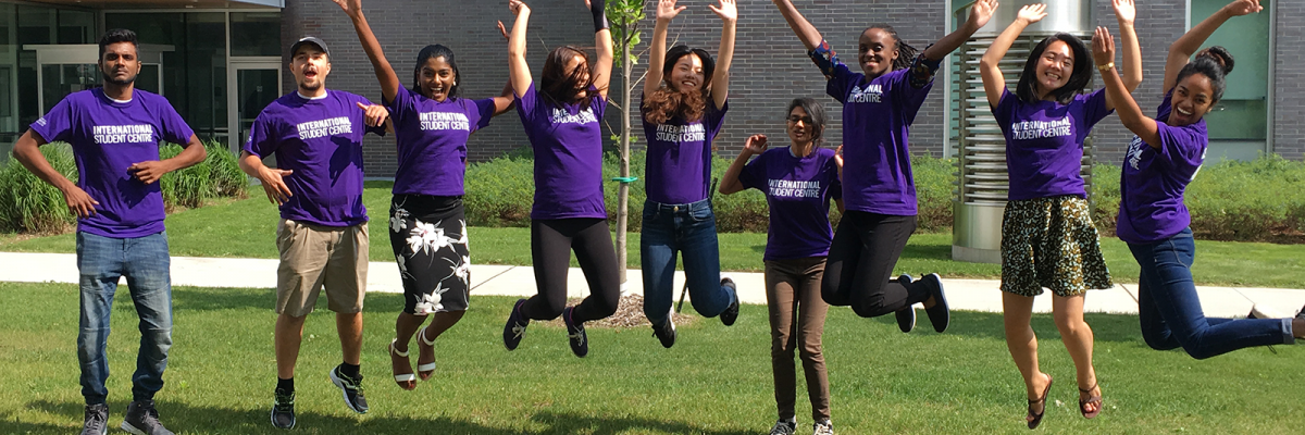 Group of students jumping for a photo